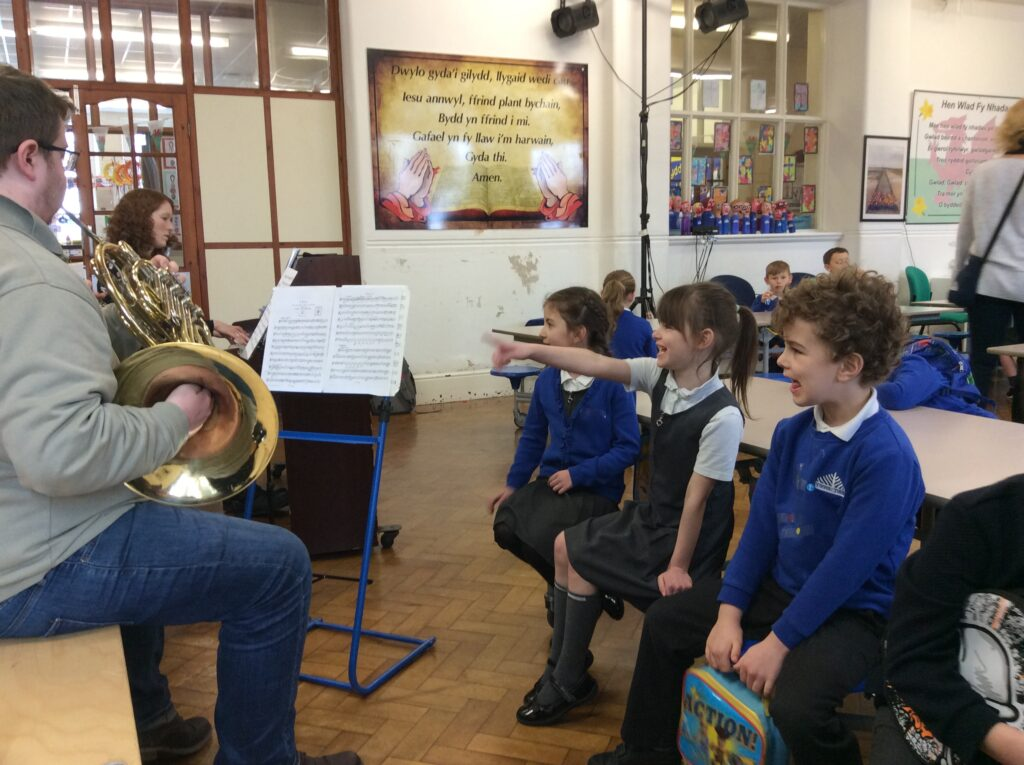 Picture of pianist and french horn player in primary school